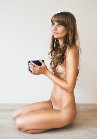nude pose: Beautiful nude girl with cup Stock Photo