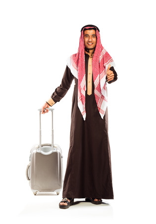 kameez: Young smiling arab with a suitcase isolated on white background