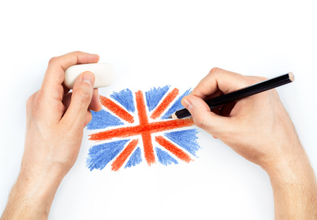 britan: Mans hands with pencil draws flag of United Kingdom of Great Britan on white background
