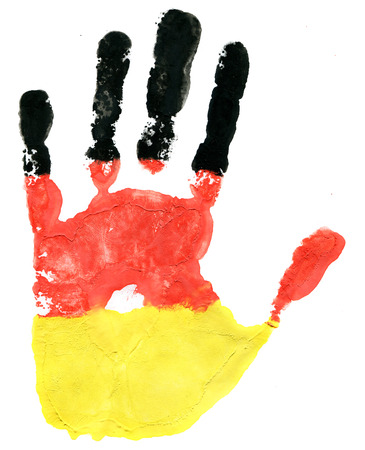 Handprint of a German flag on a white background photo