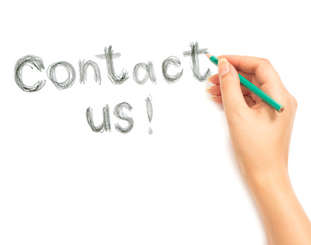 Womans hand writing contact us on white background photo