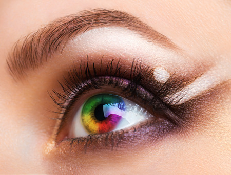 Close up Colourful human eye with makeup. Beauty and fashion photo