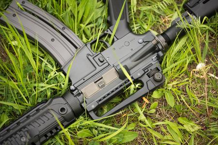 guerrilla warfare: Automatic rifle in the grass closeup