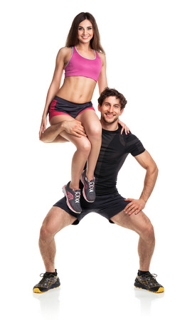 Sports guy holds on shoulder a girl on a white background photo