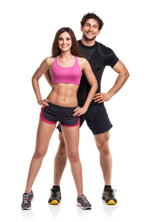 Athletic couple - man and woman after fitness exercise on the white background photo