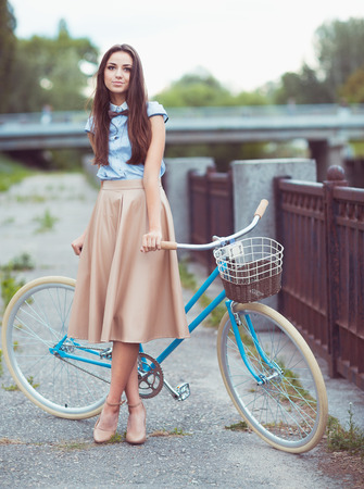 bicycle girl: Young beautiful, elegantly dressed woman with bicycle, summer and lifestyle Stock Photo