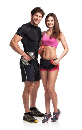 スポーツ カップル - 男性と女性の白い背景の上のダンベル