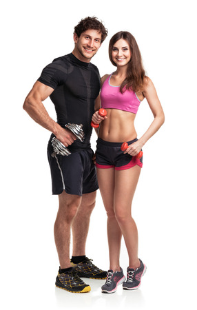 Athletic couple - man and woman with dumbbells on the white background Stock Photo