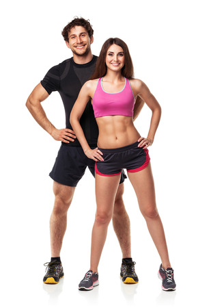 Athletic couple - man and woman after fitness exercise on the white background