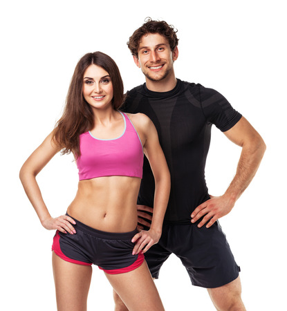 sport training: Athletic couple - man and woman after fitness exercise on the white background
