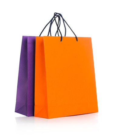 shopping spree: Two paper Shopping bags with reflection on white background