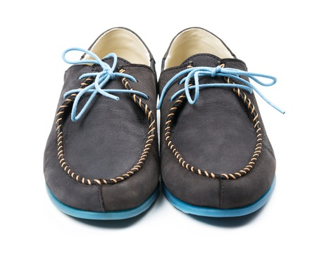 loafers: Black mens leather loafers with blue soles and laces on a white background