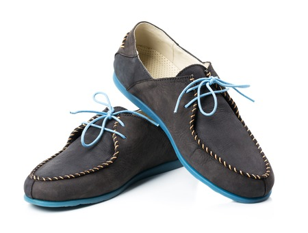 Black mens leather loafers with blue soles and laces on a white background