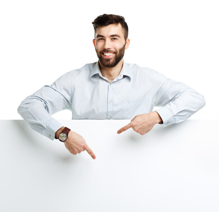 A young bearded man showing blank signboard, isolated over white background photo