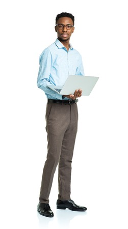 person: Happy african american college student standing with laptop on white background
