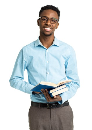 college student: Happy african american college student standing with books in his hands on white background