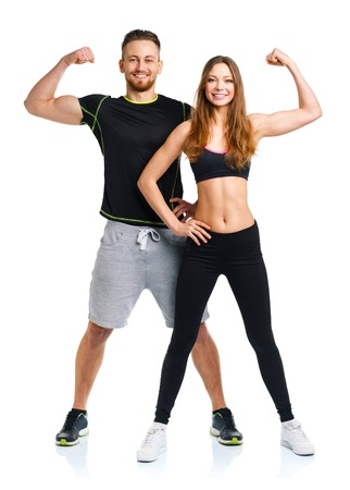 fitness trainer: Athletic man and woman after fitness exercise on the white background