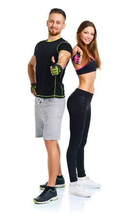 Sport man and woman after fitness exercise with a finger up on the white background