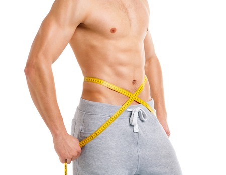 weight scales: Sport man with measuring tape on the white background