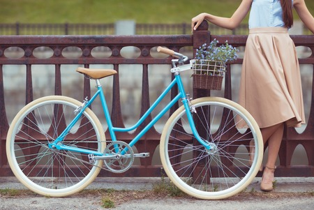 girl on bike: Young beautiful, elegantly dressed woman with bicycle. Beauty, fashion and lifestyle