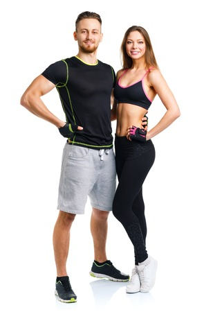 Sport couple - man and woman after fitness exercise on the white background