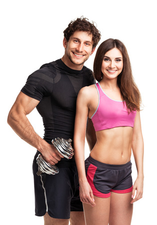 fitness couple: Sport couple - man and woman with dumbbells on the white background