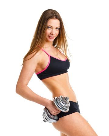jeune fille: Belle femme sportive avec des halt�res faire de l'exercice du sport, isol� sur fond blanc Banque d'images