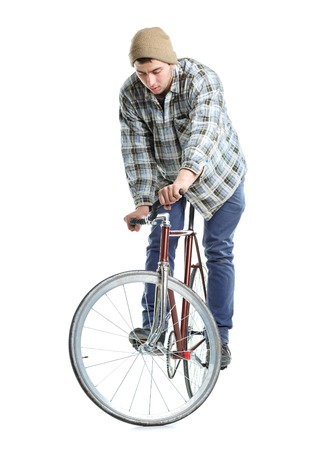 hand crank: Young man doing tricks on fixed gear bicycle on a white background