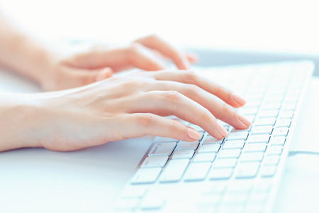 hand keyboard: Female hands or woman office worker typing on the keyboard