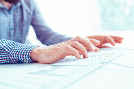 internet keyboard: Male hands or men office worker typing on the keyboard Stock Photo