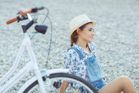 woman happy: Beautiful happy woman with bicycle on the beach