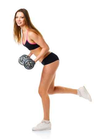 slim women: Beautiful sport woman with dumbbells doing sport exercise, isolated on white background Stock Photo