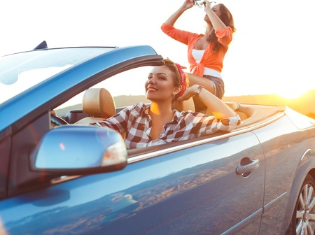 cabriolet: Two young happy girls driving a cabriolet Stock Photo