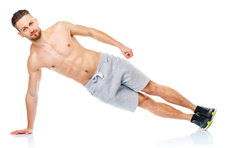 healthy men: Sport attractive man doing fitness exercises on the white background Stock Photo