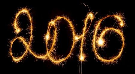 sparklers: Happy New Year - 2016 with sparklers on black background Stock Photo