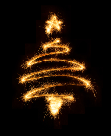 traditional christmas: Christmas tree made by sparkler on a black background