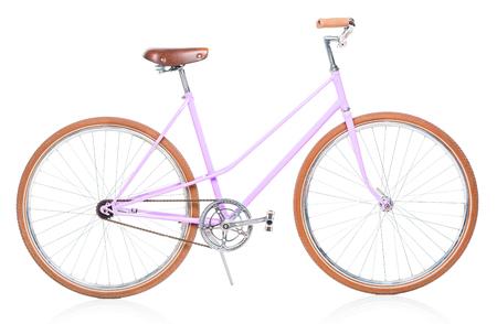 bicyclette: Femmes �l�gantes bicyclette rose isol� sur fond blanc Banque d'images