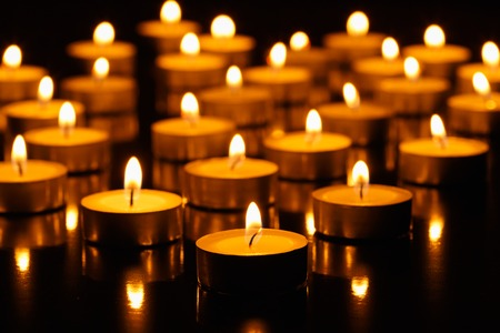 Many burning candles with shallow depth of field Stockfoto