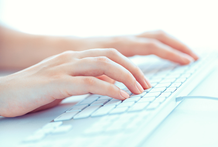 female worker: Female hands or woman office worker typing on the keyboard