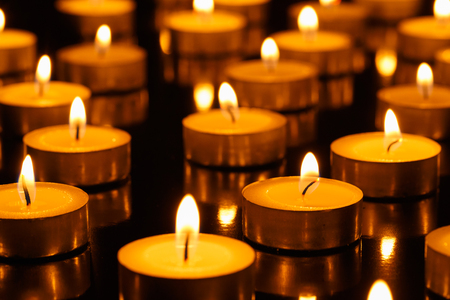 glowing candle: Many burning candles with shallow depth of field Stock Photo
