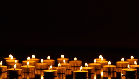 praying at church: Many burning candles with shallow depth of field Stock Photo