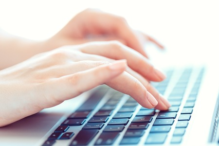 working office: Female hands or woman office worker typing on the keyboard