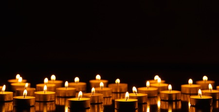 candles: Many burning candles with shallow depth of field Stock Photo