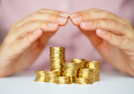 secure growth: Protect coins with hands Stock Photo