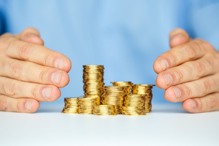 protect: Protect coins with hands Stock Photo
