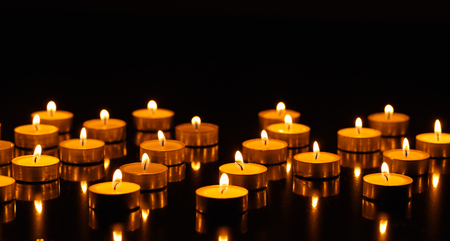 religious life: Many burning candles with shallow depth of field Stock Photo