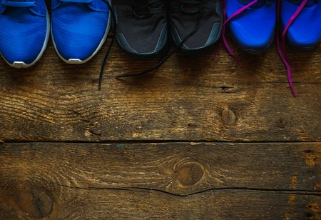 sport shoe: close up of sneakers on wooden background