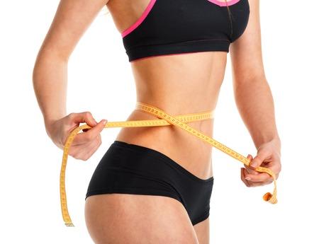cintas metricas: Woman measuring perfect shape of beautiful waist, healthy lifestyles concept