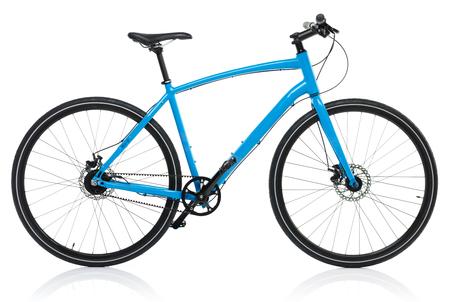 Nieuwe blauwe fiets die op een witte achtergrond