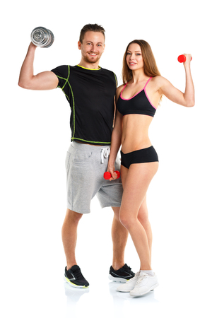 Athletic man and woman with dumbbells on the white background Reklamní fotografie